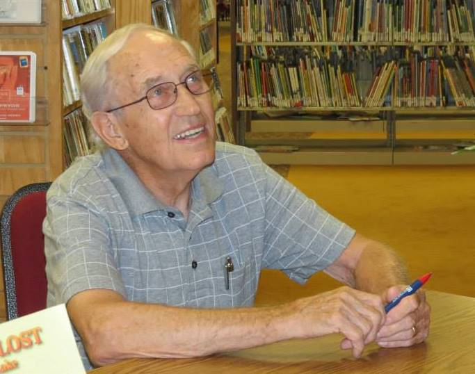 Bobby F. Edmonds, signing his books at the McCormick County Library. A longtime library board member, Bobby worked to ensure the establishment of a new library in 2004.